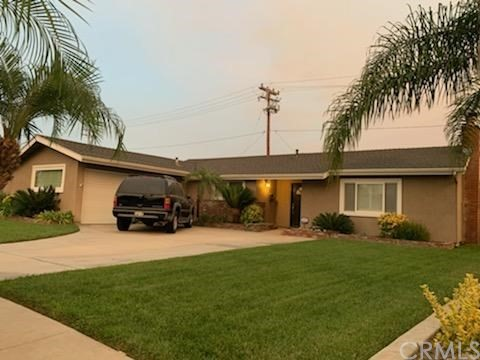 Discover this 3 bedroom, 1.75 bathroom home on a single loaded street in a quiet East Anaheim neighborhood. Enjoy two separate living areas with a large living room AND a large family room - each with a fireplace. Updated kitchen with granite counters and a gas cooktop. Master bedroom comfortably fits a king size bed, has a walk in closet, and an updated en suite bathroom with ample storage space. Two additional bedrooms with walk in closets and an updated full bathroom. Extra generously sized hallway linen closet. Interior laundry room fits full size washer and dryer and has built in storage cabinets. Wood flooring, newer windows, plantation shutters, recessed lighting, central air conditioning, ceiling fans, new water softening system, and professionally installed security system. Large, private lot with covered patio, lush green lawn, palms, and extra high walls covered in manicured green foliage. Long driveway and attached 2 car garage. Easy access to 57, 91, 55, 5, and 22 freeways. Close to Disneyland, Angel Stadium, Honda Center, Anaheim Packing District, Old Towne Orange, and more.