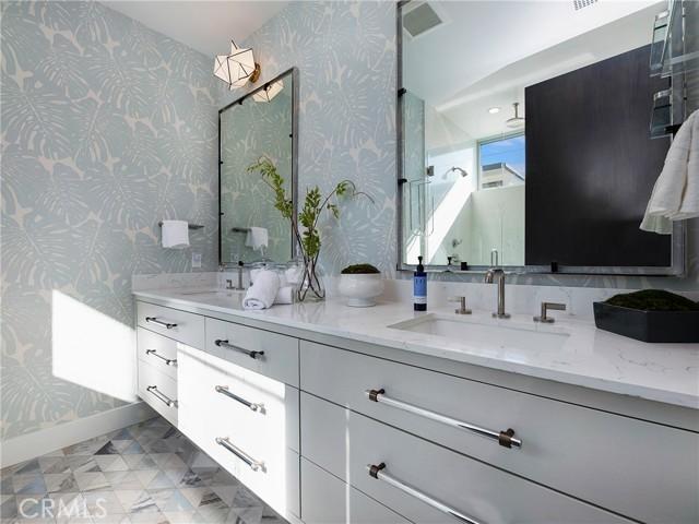 Master Bathroom, beautiful designer wall paper, dual vanities, walk-in shower and heater floors