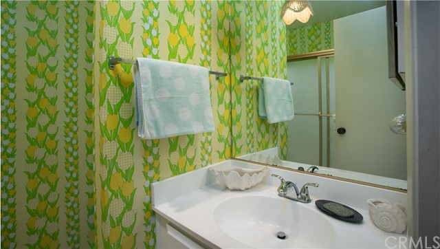 Downstairs Bathroom with cool retro wallpaper