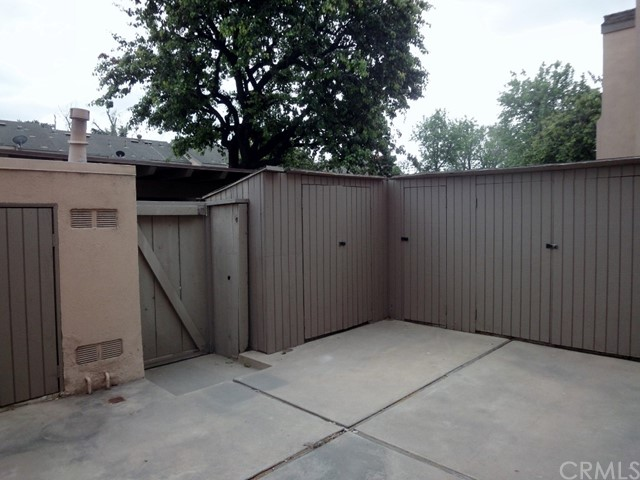 More storage Cabinets and Gate to direct access to Carport.