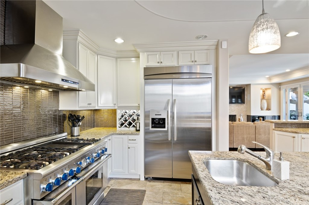 Kitchen with 6 burner Thermador stove and Thermador refrigerator.