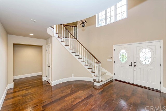 Entrance with foyer staircase, hall closet