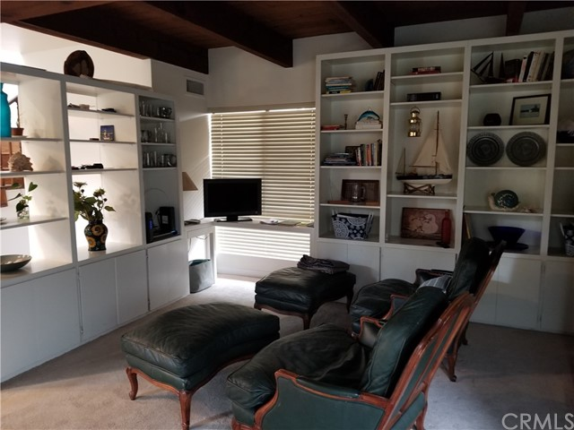 Living Room with built-ins and work space