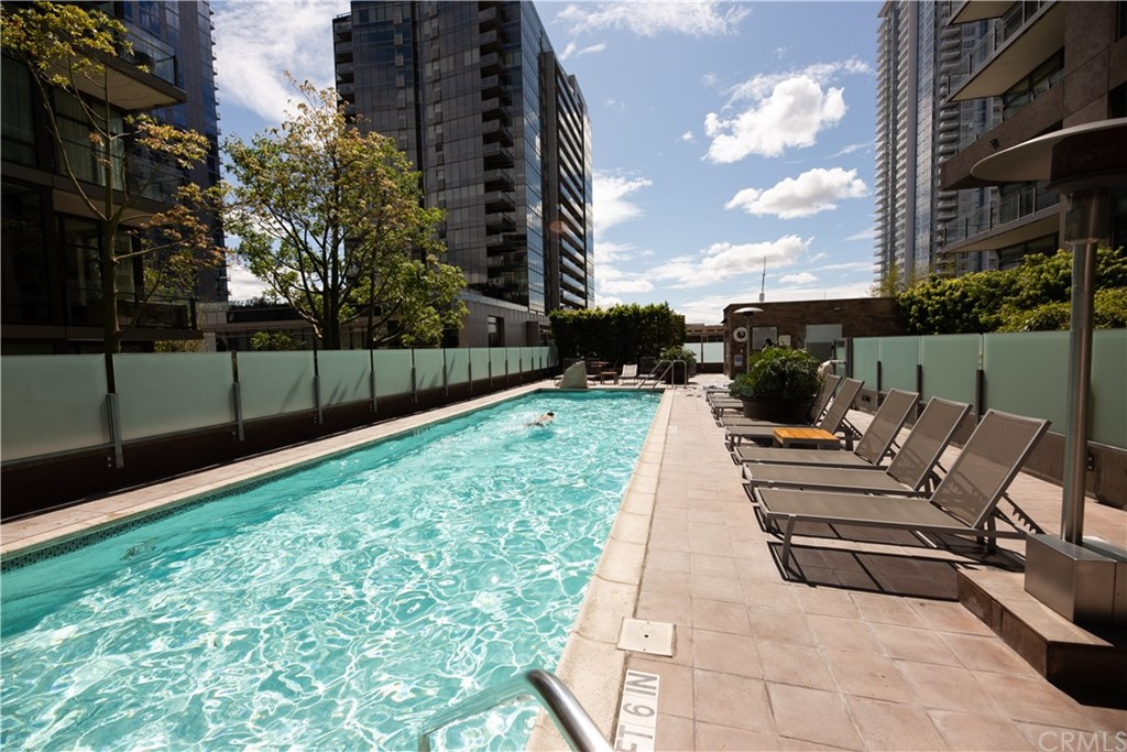 The 4th floor provides access to the expansive outdoor space with pool, hot tub, multiple seating areas, barbecues, and fireplaces.