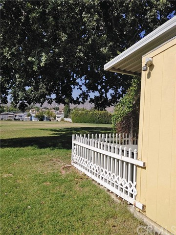 Picket fence between home and park.