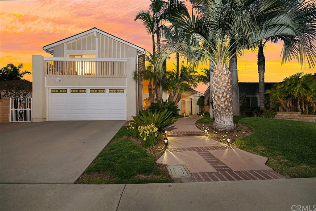 This one has it all!  LOCATION, a BEDROOM DOWNSTAIRS, PRIVATE POOL & SUNSET VIEWS!  Superbly nestled in the Castille neighborhood is this 4 BDRM, 3 BA home w/a floor plan that is sure to delight the entire family. Right from the street you'll be lured by the curb appeal. Lushed landscaping conceal a tranquil entry w/the sounds of a soothing fountain. Enter through the double doors & notice the high ceilings, formal living room w/newer windows, warm brick fireplace & separate dining room w/views of the pool. The kitchen has a newer Bosch dishwasher, gas stove, pantry w/pull-outs & a picturesque window overlooking the POOL & SUNSETS. Open to the kitchen is the family room w/crown molding & newer sliding glass door & direct access to the backyard. A sizable bedroom, 3/4 bath & inside laundry w/storage are all part of the lower level. Upstairs you'll find an expansive master suite, large mirrored closet PLUS a WALK-IN closet, dual vanities, walk-in shower and a newer ductless mini-split AC (cools & heats) lowering your overall electrical bills. Down the hall you'll find an additional bedroom & a BONUS ROOM; ceiling fans, walk-in closet & slider w/access to the completely refinished mountain view deck. Just in time for summer is this peaceful & serene backyard w/SOLAR POWERED Pebble tech pool that has been meticulously maintained & extensively updated w/over $25K in upgrades w/newer coping stones & upgraded tiles.  Low HOA, No Mello Roos & access to Lake Mission Viejo.