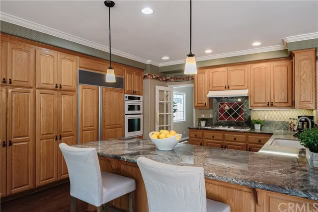 This wonderful Kitchen features lots of storage space, Sub-Zero refrigerator/freezer, gleaming granite counters, breakfast bar and more!