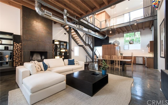 "This stunning modern loft by award-winning local architect Steven Ehrlich, AIA offers panoramic ocean views and sophisticated interiors by designer Jae Omar, just moments from the beach, Venice Boardwalk, Abbot Kinney and Rose Avenue. Come up from the beach and pass one of the main film sites for well-known TV show ""Californication."" Enter the secure gate with 4 architectural units leading to this corner unit's open, airy interiors with soaring ceilings and 2.5 story art wall. A light-filled living room features polished concrete floors, expansive windows, large fireplace and a pull-up garage door window that brings the outside ocean air in. A custom chef's kitchen is outfitted with Viking stove, oversized Sub-Zero fridge and custom cabinetry. Suspended over the living room, the master suite features a showroom closet and large master balcony. Both bedrooms offer the option for communal living with no walls or complete privacy by closing the dividers. A private entertainer's rooftop deck with corner ocean views of Catalina and Point Dume fosters a seamless transition between the levels of the loft and the grand finale with sunset facing soaking tub. This unit also comes equipped with full surround sound throughout the house; recently remodeled bathrooms; security system; side-by-side direct access garage which can be used as gym; guest parking for multiple cars; in-unit laundry. 25 Brooks exemplifies modern coastline living in one of L.A.'s most dynamic enclaves."
