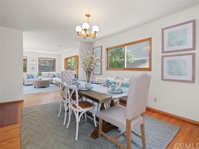 Formal dining room opens up to the family room