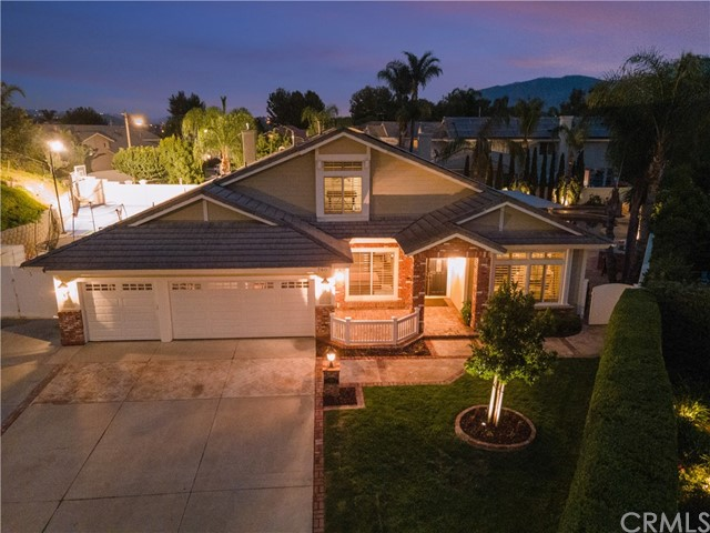 """Family Entertainer's Delight! Prestigious Belsomet gate guarded community w 24/7 security, end of cul-de-sac, oversized driveway, impeccably landscaped, sought-after ranch-style w bonus private room loft & closet, 3-car garage w charging station, double gates for low profile recreational storage, 48 energy efficient solar panels, double door entry, hardwood floors and travertine throughout, vaulted ceilings & crown molding throughout. Movie-room w 6 theatre chairs & 133"""" screen. Spacious gourmet open skylight kitchen w island, stainless steel appliances, gas cooktop w double oven, granite countertops, custom cherry wood cabinets, 3-sided gas fireplace. Enormous master bedroom w retreat & another 3-sided gas fireplace leads to bath w double vanity, oval jetted tub, glass enclosed shower & spacious walk-in closet w vaulted ceilings. Skylighted hallway. Other sizeable bedrooms w Jack & Jill bathroom & oversized closets w mirrored wardrobes & ceiling fans. Laundry room w sink. Spectacularly lit backyard includes trampoline, lighted basketball court, 4-hole putting green, beautifully designed pool & spa w firepit & custom built-in BBQ. Pristine move-in ready! Will not last!"""