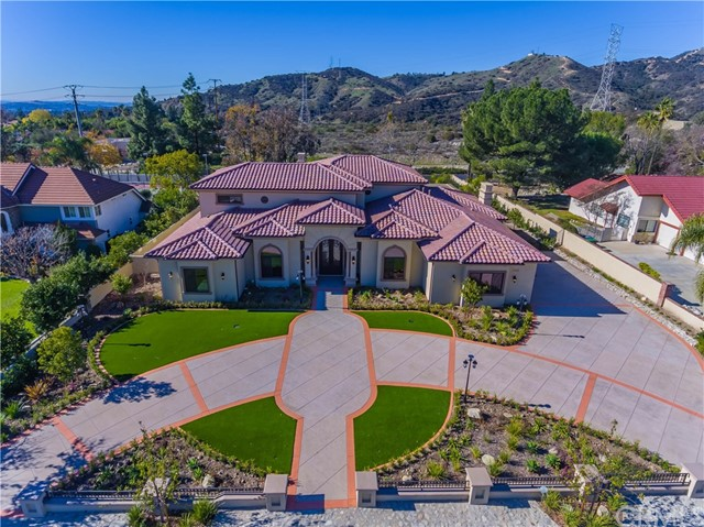 IT'S A DREAM COME TRUE! THIS BRAND NEW CUSTOM HOME OFFERS 180 DEGREE PANORAMIC MOUNTAIN VIEWS. OPEN EXQUISITE WROUGHT IRON FRONT DOORS TO THE SPIRAL STAIRCASE AND GRAND FOYER WITH DRAMATIC SOARING CEILING. NO EXPENSE SPARED IN BUILDING THIS DREAM HOME FROM THE LIGHT FIXTURES, TO THE FLOORING AND CROWN MOLDING. THIS GORGEOUS HOME OFFERS OPEN FLOOR PLAN WITH 4 BEDROOMS+5.5 BATHROOMS+HOME THEATER+EXERCISE ROOM+OFFICE + 3 CAR GARAGES PLUS BUILT IN OUTDOOR BBQ, SPARKLING POOL AND SPA, TENNIS COURT. MASTER SUITIT'S A DREAM COME TRUE! THIS BRAND NEW CUSTOM HOME OFFERS 180 DEGREE PANORAMIC MOUNTAIN VIEWS. OPEN EXQUISITE WROUGHT IRON FRONT DOORS TO THE SPIRAL STAIRCASE AND GRAND FOYER WITH DRAMATIC SOARING CEILING. NO EXPENSE SPARED IN BUILDING THIS DREAM HOME FROM THE LIGHT FIXTURES, TO THE FLOORING AND CROWN MOLDING. THIS GORGEOUS HOME OFFERS OPEN FLOOR PLAN WITH 4 BEDROOMS+5.5 BATHROOMS+HOME THEATER+EXERCISE ROOM+OFFICE + 3 CAR GARAGES PLUS BUILT IN OUTDOOR BBQ, SPARKLING POOL AND SPA, TENNIS COURT. MASTER SUITE ON MAIN FLOOR, SPACIOUS MASTER BEDROOM/DUAL FIREPLACE, STEAM SAUNA,DUAL SHOWER HEADS IN THE BATHROOM. GOURMET KITCHEN FEATURES PREMIUM QUARTZ COUNTER TOPS WITH MATCHING CABINETS,SELF CLOSING DRAWERS, COMMERCIAL GRADE GAS STOVE, DOUBLE OVEN, HUGE DOUBLE CENTER ISLANDS WITH MANY SITTING AREAS. BIG FAMILY ROOM WITH REMOTE CONTROLLED FIREPLACE IS PERFECT FOR FAMILY GATHERING. HOME THEATER ON MAIN FLOOR OFFERS BIG SCREEN, BUILT IN SPEAKERS, NEXT TO THEATER IS EXERCISE ROOM. BIG FORMAL DINING ROOM, BUILT IN WINE CLOSET WITH COOLER. OFFICE WITH BUILT IN BOOK SHELVES, WHOLE HOUSE WATER FILTERING SYSTEM, LIVING ROOM WITH FIREPLACE, OFFERS VIEW OF THE POOL. BALCONY OFF TWO BEDROOMS UPSTAIRS, TO TAKE IN THE MORNING SUNRISE AND SUNSET. YOU'LL ESPECIALLY LOVE THE SPECTACULAR GROUNDS WITH SPARKLING POOL, YOUR OWN TENNIS COURT. ARTIFICIAL TURF IN FRONT AND BACKYARD IS WATER RESISTANT. WALKING DISTANCE TO WILDERNESS PARK, HIKING TRAILS. CLOSE TO SHOPPING,FREEWAY. OWN YOUR OWN PARADISE!