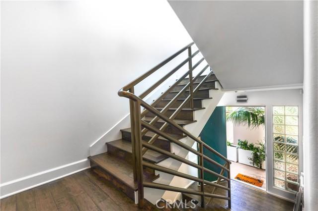Stairway showing front door, entry