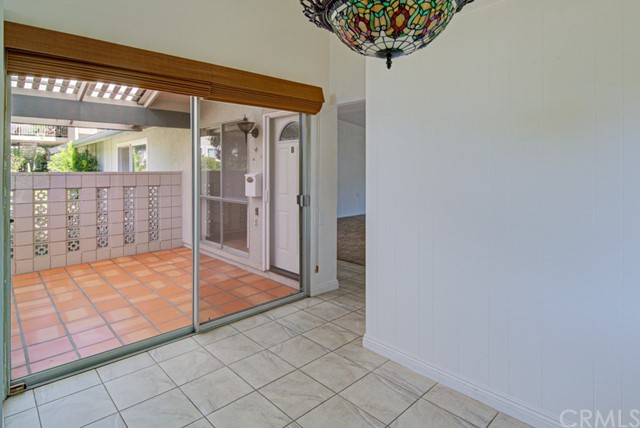 View of the front covered patio from the in-kitchen dining area.