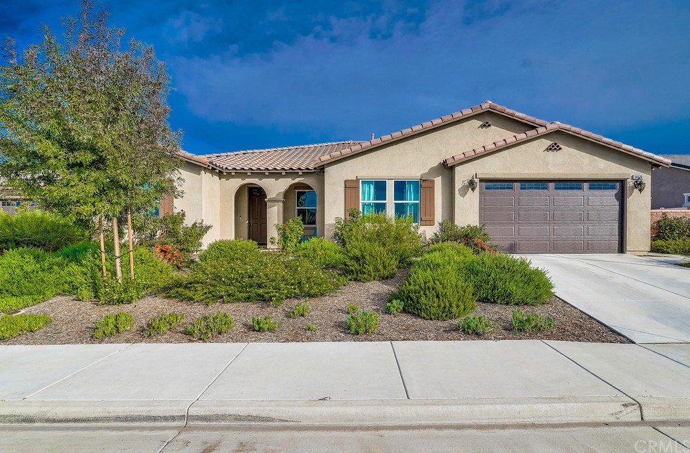 2020 could be your best year yet!  This 2016, single-story beauty has upgrades you NEED to see in person! Water-wise landscaping, a must out here, Leased Solar, Low HOA's, and a 2 car garage with storage, are just the beginning of what this home has to offer. Neutral paint and gorgeous wood-like tile floors (carpet in bedrooms) surround and lead you through a cozy front room and into an open concept kitchen offering you dreamy quartz countertops, a double oven, walk-in pantry, ample cabinet space, and an island w/seating. The generously sized family room has a mantled fireplace and luxurious chandelier lighting. This home has almost 3,000 square feet of living space (2,894 to be exact) and boasts 4 bedrooms and 3 full bathrooms (all with marble countertops!). The master bedroom is spacious with a walk-in closet and ensuite bathroom. Master bathroom has cultured marble countertops, Moen faucets, separate walk-in shower and a large soaking tub that completes this master retreat. Now. Let's talk about the backyard! Step out through the doors into your own private oasis with a SALTWATER POOL & SPA.  Extensive concrete work has been done out here and the possibilities are endless. Surrounded by greenbelts, within walking distance to city-maintained parks, and in wonderful Menifee school district. Call me today to schedule a showing and make your offer before it's gone!