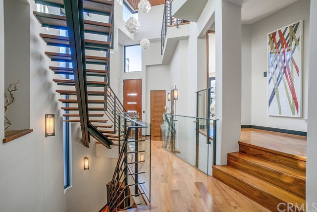 Floating staircase leads downstairs to lower level (view is from entry level bedroom hallway