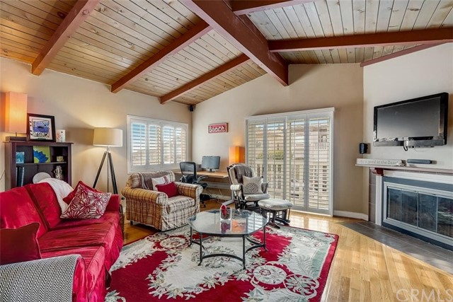 Open Beam Cathedral ceilings with wood floors in your living room
