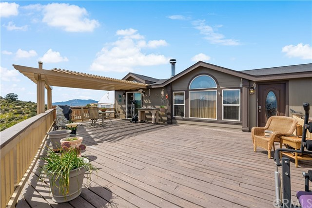 750 sq ft deck w alumawood patio cover and expansive views.