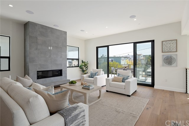 Open and versatile floor plan leads to spacious sun drenched balcony (shown here using reverse of 961 Unit A staging)