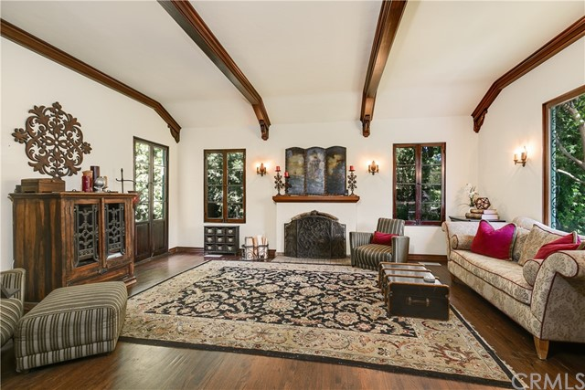 Formal Living Room with Arched Open Wood-Beam Ceiling and Batchelder Tile Fireplace