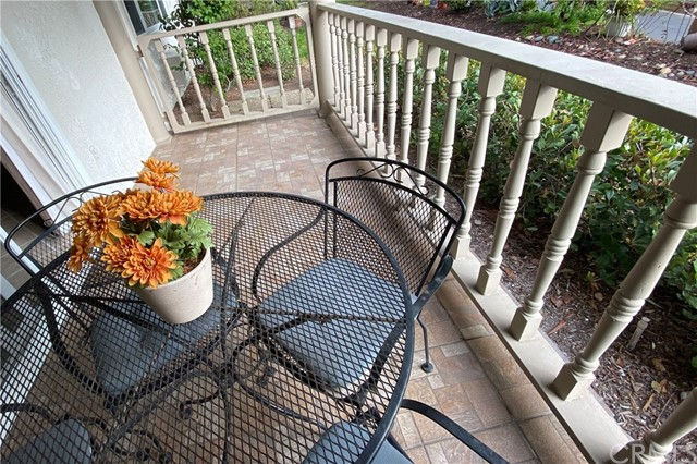 The patio gate bids you to take a walk in the surrounding foliage.