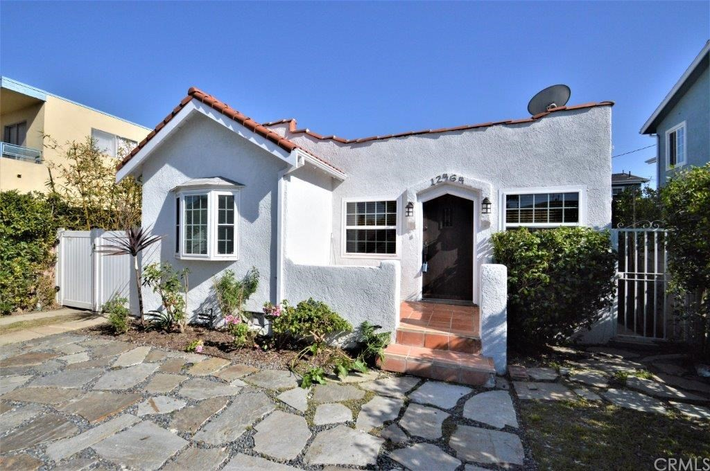 """This vintage Charmer has 3 Bedrooms, 2 Baths and an enclosed Sunroom ~ a single-family home in the prime Silicon Beach """"Del Rey"""" neighborhood. The 3rd Bedroom is detached with its own private entrance. Artificial evergreen turf in the backyard with a barbeque, storage shed, lovely garden and private patio area.   The home features an updated kitchen ~ Fridge is included, a bay windowed dining nook, breakfast bar, all open to the living room.  There are dual pane windows throughout, tiled Bathrooms and Laundry Room ~ the Washer and Dryer are included!  Vinyl gated driveway access to the single car garage.  2 flat screen TV's in the home will stay ~ one is above the living room fireplace and the other is in one of the bedrooms.  An easy walk to 'foody lane' with many local restaurants and shops (both on Centinela Blvd. and Washington). Blocks to the Ballona Creek bike path, which leads directly to the beach. Easy bike ride to Venice Beach, Abbot Kinney Blvd, Culver City, and Playa Vista. Great neighborhood for families, couples or singles. Near Glenn Alla Park and Culver West Park (tennis, basketball, dog parks, playgrounds, etc.) Don't miss the chance to make this property your own private oasis!"""