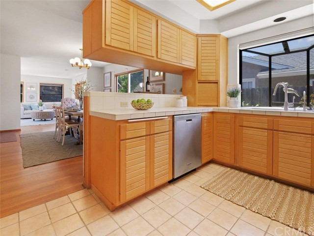 Kitchen with updated cabinetry and stainless steel appliances