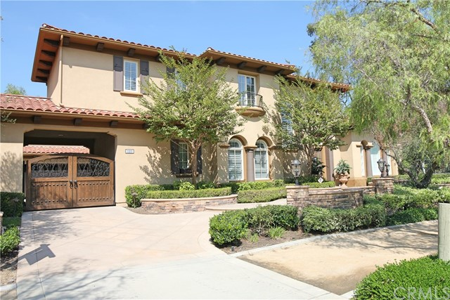 Come see this Exclusive home located in the Guard Gated community known as Tustin Ranch Estates.  This 5 bedroom 5.5 bathroom home with more than a half acre of land is ready for a new owner.  The back yard comes with a custom pool, fireplace area and large entertainment built in BBQ. This home is perfect for entertaining family and friends. The Master Bedroom has a upgraded Bathroom with large tub, walk in shower and his and her vanities. It also comes with two private suites within the Bedroom, it is HUGE!  One of the more desirable floor plans in Tustin Ranch Estates.  Too much to put on paper, this is a MUST SEE HOME if you are considering the exclusive lifestyle Tustin Ranch provides.