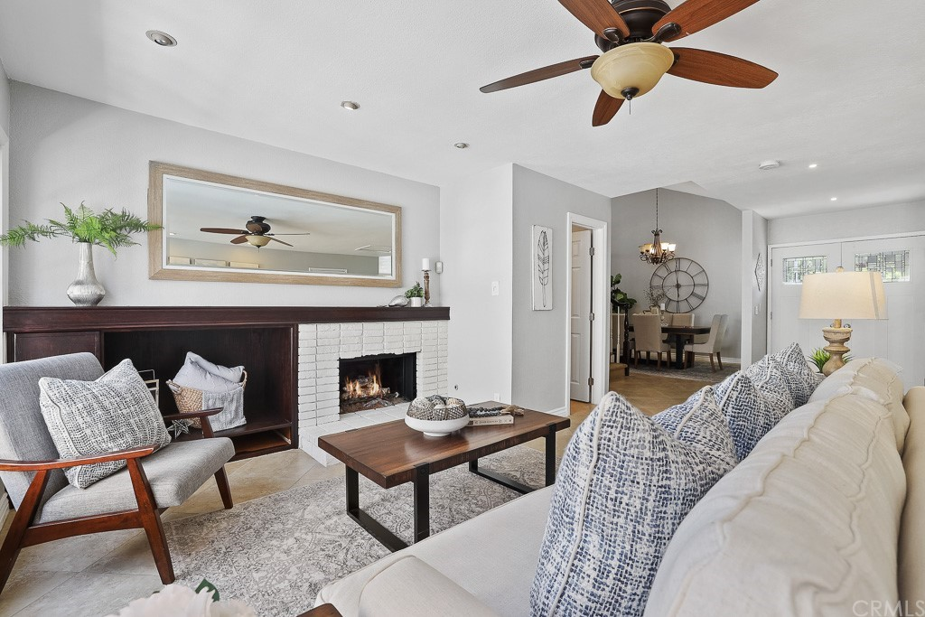Family Room has a cozy fireplace and lighted ceiling fan
