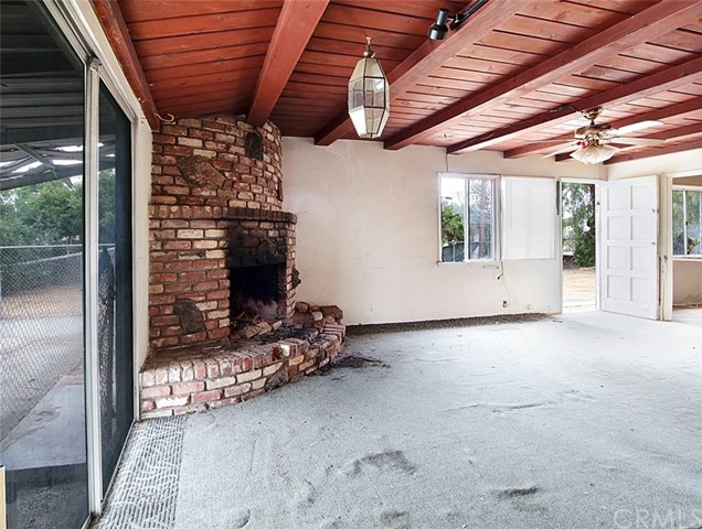 Wood burning brick fire place in the family room.
