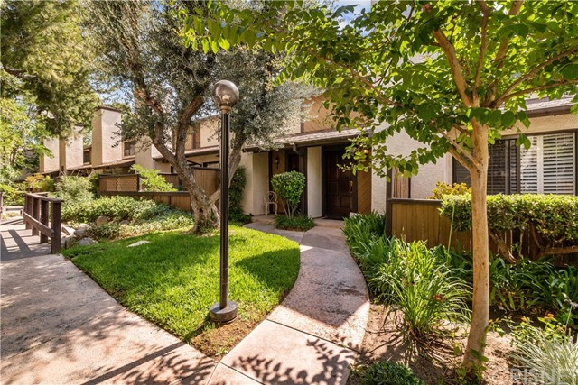 Rare opportunity in the Canyon Crest tract community Townhome! This popular double-master 2 bed, 2 1/2 bath, 2-Story end unit offers only one common wall, a large wraparound patio and direct access 2-car garage with laundry. Additional features include; stainless steel appliances, Nest Thermostat, newer Wifi/Bluetooth enabled quiet garage door opener, laminate flooring and plantation shutters on the 1st floor, under stairs storage/shelving, high ceilings in both master bedrooms and both master bathrooms offer skylights. The Canyon Crest community is known for their rocky creeks and water features and lush green surroundings and also offers a community pool and jacuzzi.