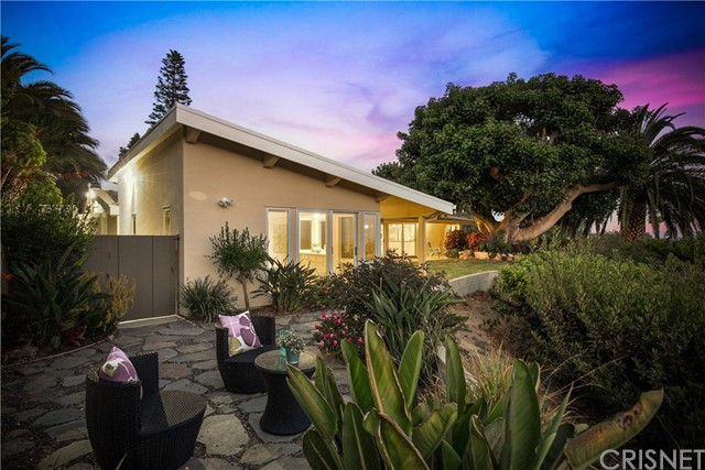 Brace yourself to be Enchanted in the Pacific Palisades with unobstructed ocean and mountain views - 961 Enchanted Way awaits you!  This single story home rests on a half acre lot that offers 100% privacy from all four sides - no eye spy with the neighbors here!  This home was recreated in 2015 to bring the outside in. All of the bedrooms and rooms have either double pane sliding glass doors or French Doors which allows the internal space to extend outside so that you can take in all of the natural beauty that the Palisades has to offer - all in the comfort of your own home.  During the re-imagination of Enchanted Way, an Enviro Water Treatment was added which supplies clean water to the entire house.  Additionally, hardwood floors were installed throughout the entire home and the kitchen features Rainbow Granite counter tops, self closing drawers, Sub Zero Refrigerator and a Paykel Dishwasher.  The master bedroom features two separate walk in closets, a soak in tub and a walk in shower and so much more that must be seen through your own eyes to truly appreciate everything that this magical property has to offer.  With Santa Monica and Malibu a short drive away, you'll be able to enjoy all the best that southern California has to offer, just minutes from you own oasis.  Exhale - you're home.