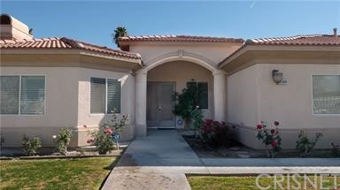 Location... Close to Everything!! 4 bedroom, 3.5 bath, 3400 sq. ft., built in 2005 with a 2 car garage. Lot size 13,939 SF. Private yard with pool, spa and covered patio. Highly upgraded with travertine tile flooring, neutral paint tones, custom front double doors and crown molding. Spacious master suite, walk-in closet, shower and only steps away from the spa. 2nd Bedroom has own bathroom. Gourmet chef's kitchen w/slab granite counters, center island, sit down bar and stainless steel appliances opens to the family room, breakfast nook and beautiful outdoor patio. Separate formal dining room with open floor plan that's truly inviting! Large 2-car garage RV parking gated on side yard. Room for everyone!!! Perfect home to entertain family and friends! A must see to appreciate. Nearby schools, shopping, and all the desert area has to offer is just minutes away.