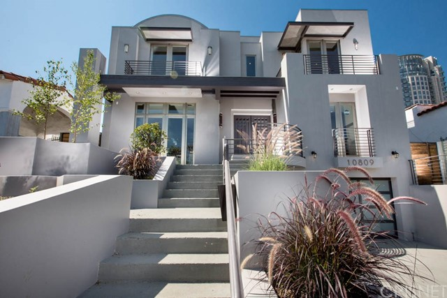 Amazing newer construction in prime Westwood location. Located behind the Wilshire Corridor you will find this one of a kind architectural 5 br+7 ba home that will appeal to the most discerning buyers. Entertain with ease in the formal living room and grand scale family room the seamlessly opens to the sunny breakfast area. Step into the gourmet kitchen and feel like a top chef with high end appliances and a large center island. Upstairs find 4 generously sized ensuite bedrooms. Let the world melt away in the majestic master wing with luxurious bath, private balcony, walk in dressing rooms & more! The lower level entertaining space is imaginative and inspired with a media room gym space and elevator. Enjoy this private oasis complete with a sparkling pool & spa and outdoor seating areas + 2 car garage. Cumaro hardwood floors throughout this 5000+ square foot home. Roof top deck!
