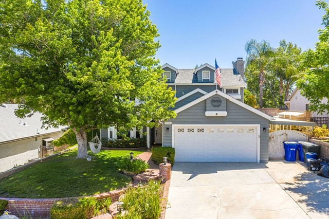 Don't miss out on this darling Castaic home with so much to offer!   Located on a great cul-de-sac!  Owned solar!  The kitchen was remodeled and expanded with beautiful custom cabinets, a large center island, granite counters, tile backsplash, stainless steel appliances and recessed lighting.  The kitchen opens up to the spacious family room with a cozy fireplace as well as an office niche perfect for anyone in need of a home office.  Tile flooring and crown molding throughout the downstairs.  The sellers installed custom barn doors to create an additional 4th room in the dining room that can easily be converted back.  Three bedrooms and 2 full bathrooms located upstairs, half bathroom downstairs.  Ceiling fans in all bedrooms.  French doors lead to the backyard with a nice grassy area and stamped concrete patio.  2-car garage with direct access.  No rear neighbors, No HOA and No Mello Roos!  Great freeway access!!