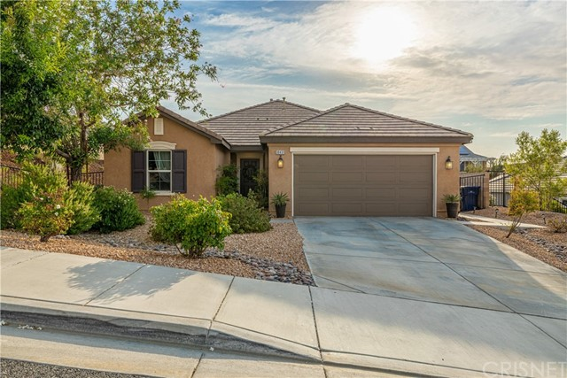 Pride of ownership is evident in this well maintained West Palmdale home !  You'll feel right at home when you enter this gently lived in, well cared for bright and updated home.  Palmdale hill views and city light views are beautiful.  Built in 2009 this 1919 sq. ft' beauty has it all.   A perfect combination of casual living and todays style.  It is situated on a corner lot with plenty of privacy.  This 4 bdrm  (1 bdrm currently used as a home office)  2 full bath home has, room for all your needs.   Bright kitchen has an island and plenty of counter/cupboard space.    Kitchen is open to the great room living / dining area.  Direct access to the covered patio and tastefully landscaped back yard.   Roomy master bedroom has a walk-in closet and an on-suite bath.  2 car direct access attached garage.   Local community services, shopping and schools are close by.   Just minutes from the 14 frwy makes this home a convenient location for commuting,  or just happy living.   Set your appointment to tour this home a.s.a.p.-this one won't last !!