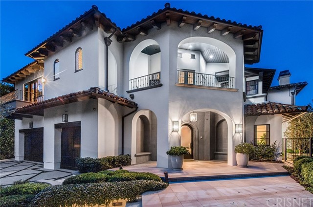 Completely redesigned Mediterranean on prestigious lower Tigertail Road in Brentwood & tucked behind gates for complete privacy, this 9,000 sqft custom-designed estate welcomes you home with a bright & airy center hall that leads to the large family room with custom paneling, fireplace, & dual french doors to the leafy back yard. The grand chef's kitchen boasts a spectacular center island, tons of storage in custom cabinetry, 8 burner Wolf range w/ double ovens, Sub-Zero refrigerator & freezer, 2 dishwashers, temperature controlled walk-in wine cellar, & walk in pantry. The layout is ideal for entertaining with a formal living room w/ cozy fireplace, formal dining room, & game room w/ fireplace & custom cabinetry. The backyard is beautifully landscaped & presents plenty of space for al fresco dining, sunbathing by the sparkling pool & spa, & gathering around the outdoor firepit. There is also an exterior powder room & an outdoor shower. Also downstairs is a large laundry room & staff bedroom & bath. Upstairs are 5 bedrooms, all w/ en suite baths, a bookshelf-lined study, & game/media room perfect for the kids. The serene master offers a fireplace, separate retreat area & 2 balconies overlooking the backyard. The master bath has dual sink vanities & 2 private closets, walk-in steam shower & separate soaking tub. Within the boundaries of Palisades Charter High School district, this home is conveniently located to shopping, restaurants, and all Brentwood has to offer.