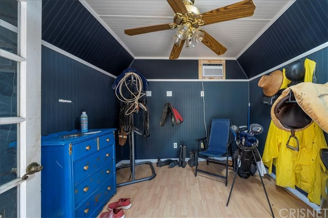 Tack room has air conditioning, light and electrical outlets.