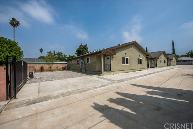 """Opportunity knocks! Located on an expansive 19,945 sq ft lot, this 6 Unit """"duplex style"""" apartments are available on a private gated lot. BUILT NEW IN 2019, each Unit comes with central air & heating, INDIVIDUAL electric, gas & and WATER meters. Each Unit features a 2019 installed tankless water heater, in unit washer / dryer hook-ups, NEWER exterior & interior paint, and offers low maintenance hardscaping with tenant assigned open pad parking. Each 3 bedroom / 2 bathroom Unit offers 1,275 sq ft of flowing living space and features a modern open-floor plan concept, with warm laminated wood flooring, recessed lighting, and soundproof dual glazed windows with window blinds treatments. The kitchens have been redesigned with Quartz counter tops offering generous counter tops space, ample over and under counter storage, and built-in stainless steel appliances. The secondary bedrooms in each unit have sliding mirrored wall closets, and access to a full hallway bathroom with glass shower tub enclosures. The master bedrooms feature a full private master bathroom and walk-in closets. This private gated community is close to medical facilities such as Providence Holy Cross, Olive View, and Facey Medical Center. Mission College and CSUN 10-15 minutes away. Metrolink services are located just down the street, and offers easy freeway access to the 405, 5, 118, 210 and 14 freeways. 12516-12518 1/2 San Fernando Road will not last."""