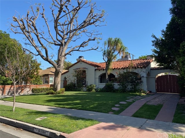 Beautiful 1930's Spanish style home walking distance to Universal Studios and Metro with great natural light and outdoor space. This listing includes the two-bedroom two-bath home AND 900 sqft converted garage/backhouse (with bathroom). The home has a formal living room with fireplace, dining room, kitchen, master bedroom with large bathroom and large closet with washer/dryer hookups, second bedroom with additional sun room, hall bathroom with separate tub and shower. This home has been cared for by the owner and includes many charming character features. There is large backyard with spa. Garage/backhouse would be great to host family, sublease out, have a separate office, move theater, etc. Landlord pays gardener and spa maintenance. Tenants pay remainder of utilities. The garage is a potential ADU for sublease. Lessor (tenant) would be responsible for the sublease (occupants actions, rent, utilities, damages, etc.). Must have renters insurance with a $100K liability limit and owner as additionally insured. One year lease minimum. Lessor (tenant) would be responsible for the sublease (occupants actions, rent, utilities, damages, etc.). Must have renters insurance with a $100K liability limit and owner as additionally insured. One year lease minimum.