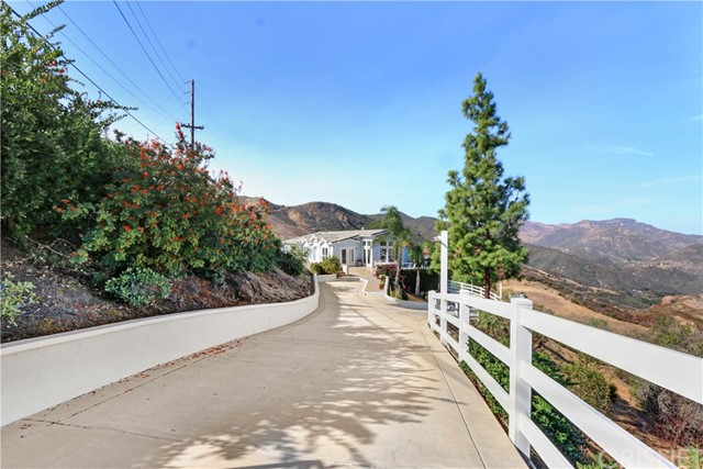 This is A Once-in-a-Lifetime Investment Opportunity to acquire a single tenant 100% absolute triple net leased property in Malibu, one of the most significant & prestigious residential compounds in the United States. This exceptional and unique gated home with complete privacy and explosive unobstructed panoramic mountain views with Approx. 4 acres of land has endless possibilities with extra room to add a detached garage, a huge guest house, pool & spa, tennis court, basketball /sports court, playground and much more. Interior features bright and open floor plan, 5,066 sq. ft.,5 bedrooms,4 baths, constructed in 2002 with sensational high quality finishes throughout, spectacular resort-style outdoor sitting area with magnificent mountain views and so much more. This residential income opportunity features a NNN lease with monthly income of $15,000 Cap Rate of 6.66%. The tenant is an established Drug & Alcohol Rehab & Treatment Center which is holding a sub cense Abuse Drug & Alcohol license & certification approved by state of California and Federally holding JCAHO, Joint Commission on Accreditation of Healthcare Organizations. This property may be purchased individually or a portfolio sale, 415 Westlake Blvd (next door MLS#SR20200563) listed at $4,750,000 NOI: $240,000 Cap Rate of 5.05%. A new lease contract will be arranged before close of escrow.