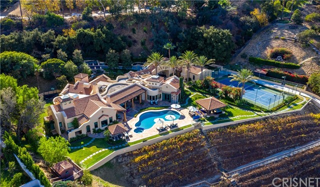 A one of a kind Richard Landry single story villa perched atop a completely private 7 acre estate with stunning 180° views.  This exquisite resort estate features a salt water pool/spa, outdoor BBQ dining area, Tennis/Basketball Court, Koi Pond, and several private hiking trails that encompass the magnificent grounds. Just beyond the pool an award winning vineyard is set on the lush hillside producing Cabernet Sauvignon , Merlot, and Viognier. The home boasts a custom built professional screening room, self sustaining energy features, custom finishes ,high ceilings, bright interiors engulfed with natural light, and large windows providing incredible unobstructed views!