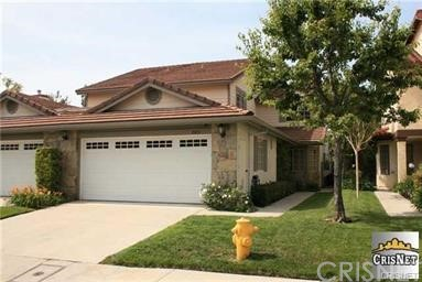 Stunning Porter Ranch Executive Home in Gated Community . This home features 3 bedrooms, 2.5 baths, Master Suite/Bath with huge closets and private balcony. Great Floor Plan with Living Room, Formal Dining Room, Family Room w/fireplace. The cook's kitchen has loads of counter and cabinet space.  Large open floor plan, inside laundry room and two car garage, The rear grounds boast a lush landscaping, covered patio and very private. The community provides pool, spa, tennis court, +++. Great school district. Quiet neighborhood