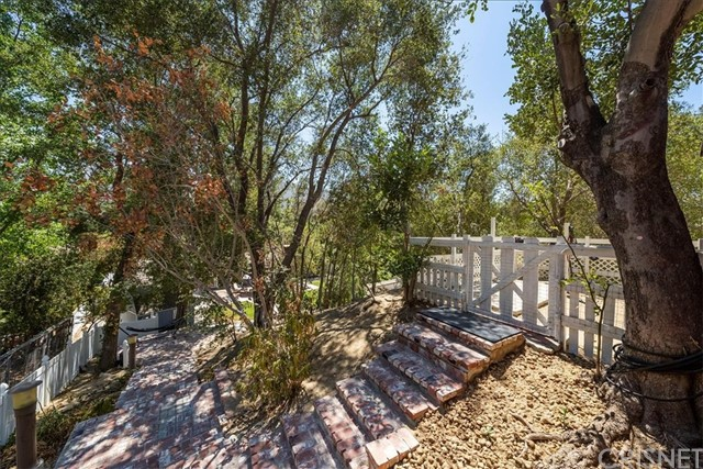 Over 60 mature trees on this property. Lots of redbrick that compliments the EQUESTRIAN home.