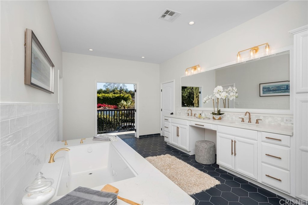 Master Suite Bath with Dual Sink Vanity, Make Up Counter, Over Sized Jetted Tub, Large Shower with Dual Shower Heads and Spray Bars, High Ceilings and Private Water Closet