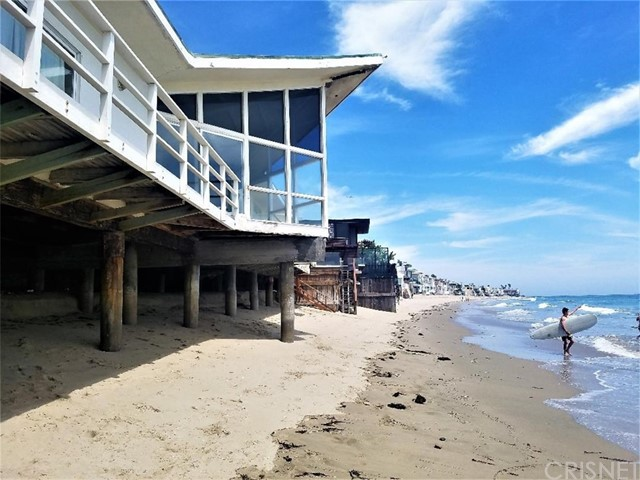 This spectacular 120 feet* of ocean frontage property is all about the lot, which is one of the largest on La Costa Beach. The property is a legal duplex with two detached units connected by a breeze way. One unit is a 1 bed, 1 bath, kitchen, living room, and nook area. The other unit is a 3 bed, 3 bath, full kitchen, formal dining room, and living room. There is tremendous potential here to remodel and possibly add addition space or to build the trophy Malibu beach home to rival all others. There were previously approved plans (now expired) for a 7370 sq ft, two story estate. It is up to the buyer to investigate all aspects of the property and what improvements that can be made. *Measured at the PCH side of the lot.