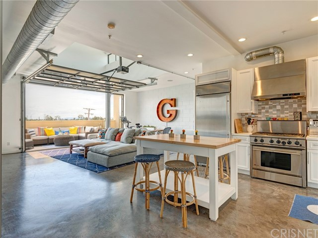 Santa Monica Modern Living At Its Best! This unique top floor loft-style living features 1 bed, 2 baths, approx. 1,380 sq. ft. designed by notable architects Pugh & Scarpa. The unit features open floor plan with indoor/outdoor living with a trendy roll up door that opens to the living room onto a spacious patio with city views. High ceilings with natural light throughout this property. Updated kitchen with quartz counter tops, beautiful backsplash, and high-end stainless-steel appliances. Down the hall you enter the modern master bedroom with its own en-suite bathroom, dual master sinks, quartz countertops, and a large closet. Extra cabinetry and storage throughout including a built -in Murphy bed for guest with extra closet in the hallway. Inside laundry and 2 side by side parking spots included. Great location close to the Expo Line, 10 freeway, the beach, great restaurants and retail stores.