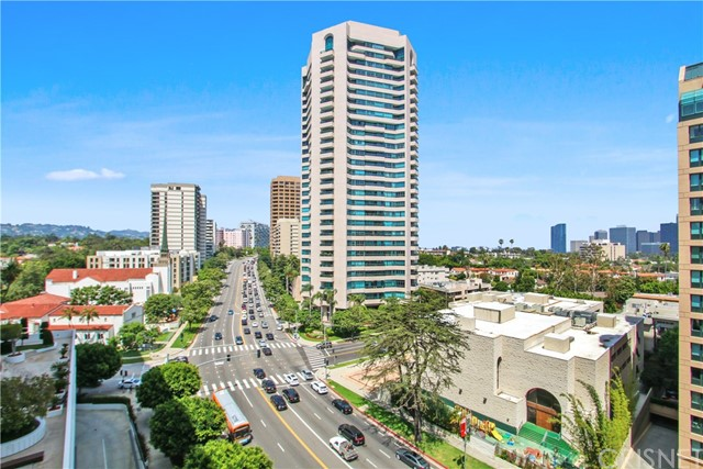 This is the Condo that you have've been waiting for. Sunny residences with spectacular views, the Wilshire Corridor skyline to the city lights beyond. Corner 12th floor unit at the luxury Wilshire Marquis high-rise. One of the largest floor plans available! Spectacular South facing views of Century City, the mountains, and the Corridor from the living room, bed rooms, kitchen, and private patio. Wide hallways lead to two spacious bedrooms, open living/dining layout with fireplace, and gourmet kitchen. New paint, Marble floors and granite counter tops throughout, and exquisitely renovated bathroom.Built-In Cabinets, Marble Spa Tub & Shower in Master Bath. Custom kitchen with breakfast counter, recessed lighting, and stainless appliances. Master bedroom features walk-in closet and remodeled en suite bathroom. Great location.This building offers 24-hour security, concierge service, secure parking, tennis courts, pool, spa, gym. Extremely low HOA dues on the Corridor. Olympic Size Pool, Outdoor Spa, Sun-Deck, Lovely Deck-Level Garden Patio, Gym w/ Locker Room & Sauna, Rec Room, BBQ Area, 3 Tennis Courts Including 2 on Roof-Top. Elegant Lobby w/ Concierge, 2 Pkg Spaces in Gated Garage, Ample Guest Parking. Extra Storage Unit Avail.Walking distance to Beverly Hills, UCLA, Westwood Village, Shops, Theaters, Restaurants and Public .