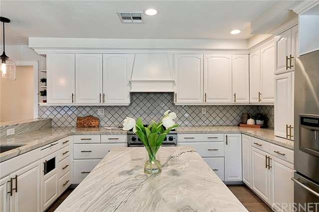 Don't miss this stunning ranch home nestled in oaks of the wildly popular Placerita Canyon. Completely remodeled, single story. Design elements like ship-lap, brick, wood and marble best describe this incredible ranch home. In addition, this home has OWNED SOLAR and is completely wireless with a smart NEST thermostat, RING door bell and more! Need handicap access? This home is ready. Let's talk about the kitchen: Stainless steel Viking stove and dishwasher, concrete sink, double oven, gorgeous white cabinetry with under-mount lighting, brushed brass accents, spacious kitchen island and stunning black splash. Additional upgrades include: crown molding, shutters, roman shades, custom wood mantle over fireplace, wine fridge in dining room, custom built bookcase in office, painted tile floor in bonus room, and closet organizers in master bedroom. Entertainers yard with covered patio, fire pit, beach entry SPA, mature trees and a very cool pond with water wheel. Back yard is fully fenced and irrigated with new sprinkler timers. New tough shed, and spacious dry-walled shed that could be an art studio, craft room or more. Tons of citrus trees. This home is close to the famous Melody Ranch, Downtown Newhall and the 5 freeway. Convenient proximity to the private gate for ease of access. Tour today! You won't want to miss this home!