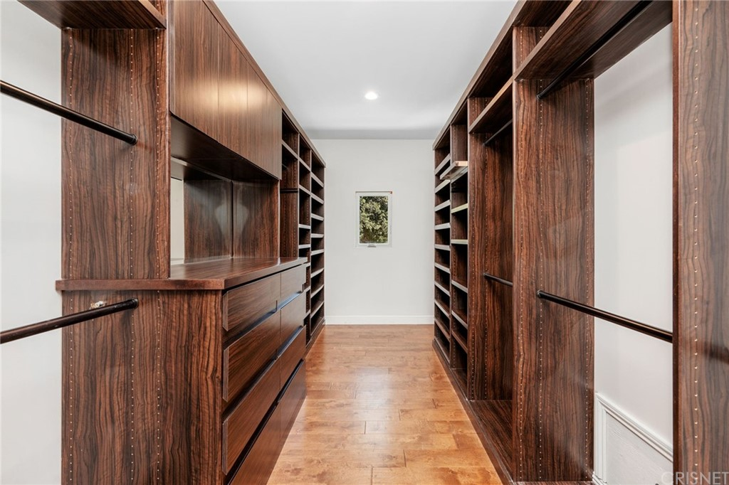 Master Suite Walk-In Closet with Custom Built Ins and Locking Dresser with Jewelry Drawers