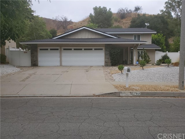 Calabasas home nestled in the Saratoga Hills neighborhood with 5 bedrooms, 3 baths. One bedroom/one bath on main floor. Remodeled open concept kitchen to the family room, offering subzero refrigerator; viking professional 6 burner stove; double oven; and viking microwave; center island; granite counters; large pantry; custom cabinets has plenty of storage with soft close and roll outs; Italian porcelian tile and marble flooring, shutters, recessed lighting throughout, 2 separate HVAC units for upstairs and downstairs; master bedroom offers a  wood burning fireplace, ensuite bathroom with dual sinks, separate commode and bidet, plus walk-in closet.  Outdoors offers sparkling pebble pool and Jacuzzi, plus lots of room to entertain and lounge with covered patio, and stamped concrete. Outside SHED for extra storage and 3 car garage. Award winning Las Virgenes Schools.  Easy access to hiking, biking, freeways and short commute to the westside and beaches. Includes pool, gardener and pest control services.